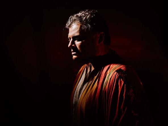 "Aleksandrs Antonenko in bronze makeup and standing in shadows for a publicity photo for Verdi's ""Otello"" at the Metropolitan Opera.Credit Kristian Schuller/Metropolitan Opera"